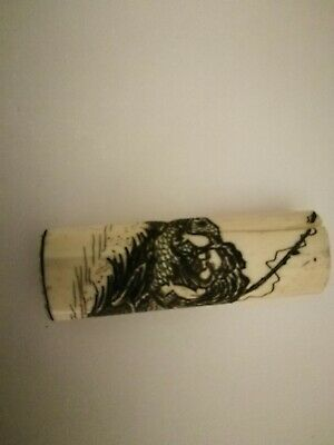 Scrimshaw etched shipwrecked sailor saved by large fish