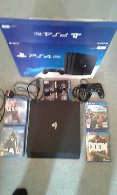 PS4 PRO 1TB Game Console - Black with 5 games.