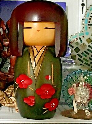Japanese wooden Kokeshi doll. Signed ,and hand painted