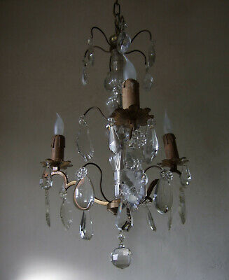 ANTIQUE ORMOLU  with ground crystal drops three branch chandelier