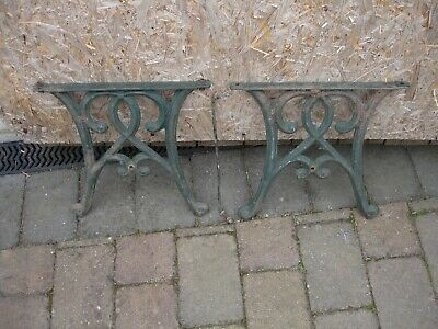 Ornate cast iron legs/ends for a garden bench or low table.