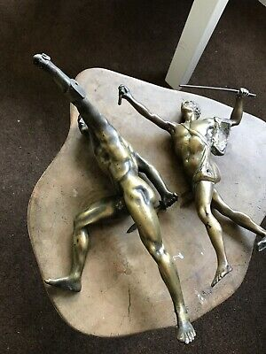 Two antique bronze male nude figures