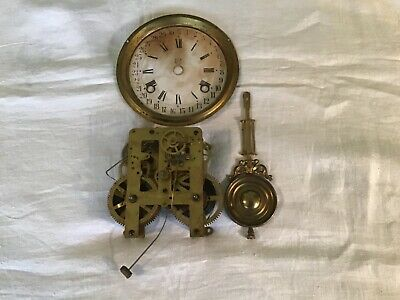 Vintage Waterbury Wind Up Clock Movement with Pendulum and Face