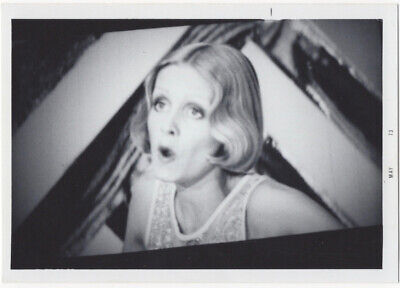 Woman apparently singing on TV or movie screen, 1973