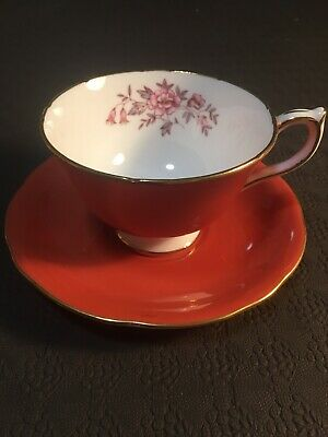 Aynsley Burnt Orange Tea Cup And Saucer With Pink Flowers