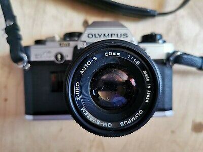Olympus OM10 35mm SLR Film Camera with 50mm Lens Fully Working, new Batteries