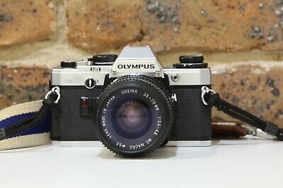 Olympus OM-10 35mm SLR Film Camera + Cosina 35-70mm Lens + Papers and Case