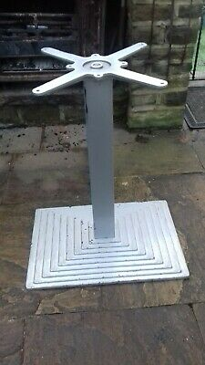 industrial cast iron table base. Old factory canteen furniture.