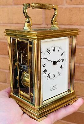 A Fine Quality Vintage Heavy Brass Sewills Of Liverpool Striking Carraige Clock.