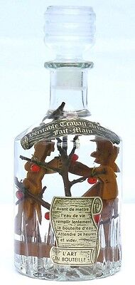 French bottle whimsey with two orchard workers picking apples.