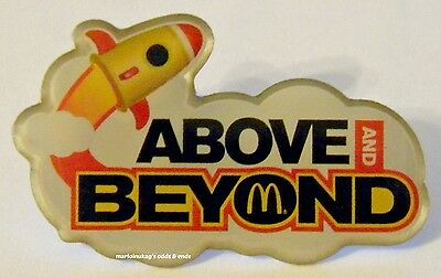 New In Package McDonalds Above & Beyond Rocket Ship Lapel Pin. FAST SHIPPING!