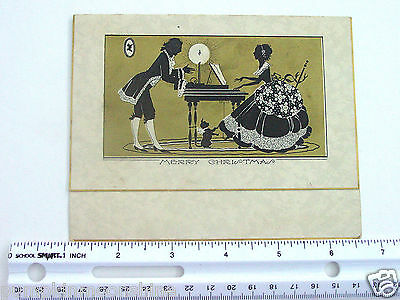 #E5- Vintage Gold Embossed Xmas Greeting Card Victorian Couple Playing Piano
