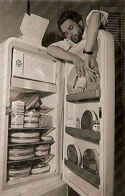 1961 GUNS OF THE TREES Adolfas MEKAS putting stocks of film in a fridge *Photo