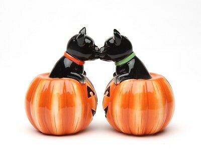 CUTE BLACK CAT IN PUMPKIN SALT AND PEPPER SHAKERS.MAGNETIC ATTACHED. HALLOWEEN