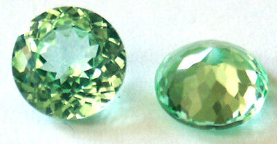 A pair of 5 mm Fancy Double Round brillant cut Light green Created Spinel