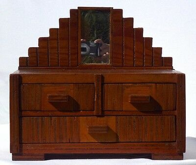 A three drawer Art Deco style dresser box with unusual construction.