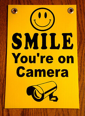 "SMILE YOU'RE ON CAMERA  SIGN 8""x12""   NEW with Grommets Security Surveillance"