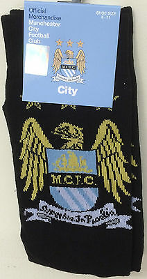 Manchester City  official adult dressed socks new with tags free posting UK