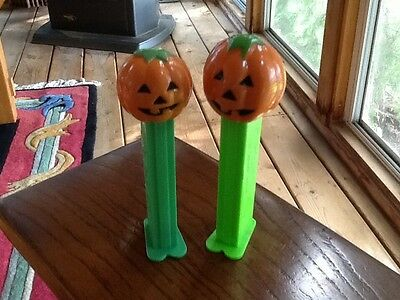 Two HALLOWEEN Collectible PEZ Dispensers 1980 small and large PUMPKIN HEAD