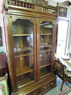 Antique Victorian Bookcase with two glass doors over two drawers w/ metal acorn
