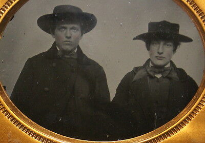 "Ambrotype, James A. Eaton & Friend. 1/6 Plate - 2 5/8"" x 3 1/4"". In worn leather"