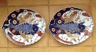 A pair of mid 19th century Japanese imari dishes decorated with carp