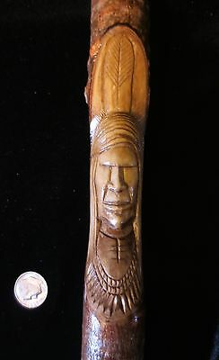 Brave's Head Talking Stick, traditional motifs carved by Erik Sappier Penobscot