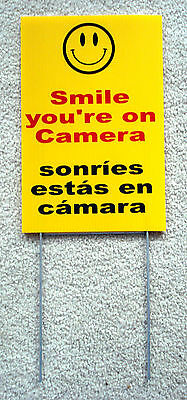 """SMILE YOU'RE ON CAMERA SIGN 8""""x12""""  w/ Stake Security Surveillance Spanish"""