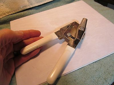 Used Swing-A-Way brand manual kitchen can opener.