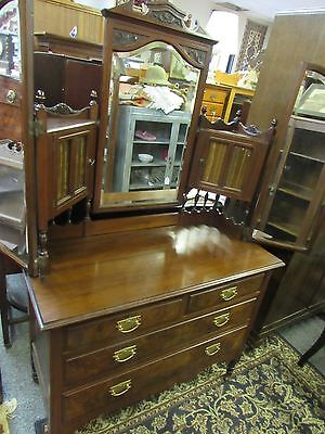 Antique vanity w/ triple beveled glass mirror two doors over four drawers