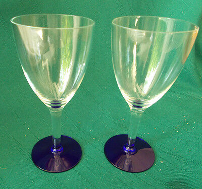 "Set of 2 wine glasses 5-1/2"" tall. Clear tops and stems, cobalt blue bases"