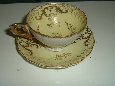 YELLOW MOTHER OF PEARL CUP & SAUCER WITH GOLD GILT