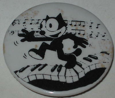 "Felix the Cat Piano Keys Pin 1.75"" Has Spots"