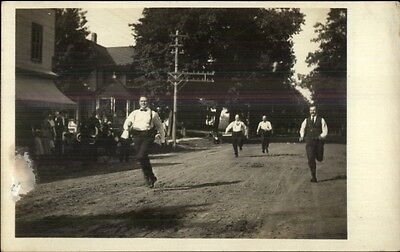 Men in Ties Suits Running Race in Town c1910 Real Photo Postcard