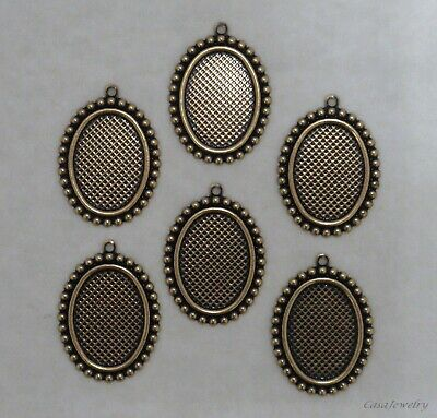 X1157 ANTIQUED GOLD 18X13 BORDERED BEZEL W/TOP HANG RING- 36 Pc Lot (QTY DISC)
