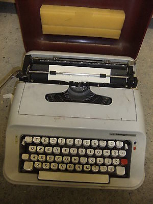 Typewriter ADLER junior-E  plus hard cream case portable quality + INSTRUCTIONS