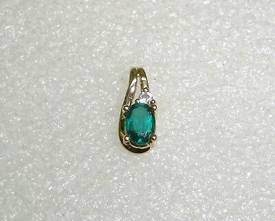 Lab Created Emerald Pendant With Cubic Zirconia Accent In 10K Yellow Gold N560-I