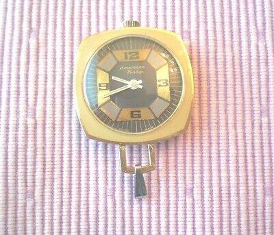 AMERICAN HERITAGE PENDANT WATCH SWISS MADE, Gold Tone / Running