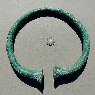 an ancient ornate copper alloy bronze neck torque from nigeria cross river