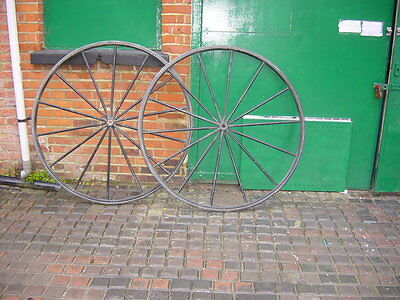 "pair of 14 spoke steel carriage wheels 50"" dia rims and clincher rubber tyres"
