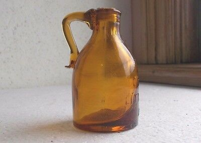 Our Little Pet Jug Amber Crude Drippy Applied Handle Mini Jug With Cork Stopper