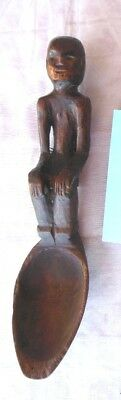 """Small 7"""" Antique carved wooden spoon seated figure with backpack hands on knees"""