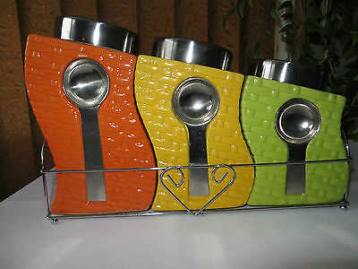 Set Of 3 Ceramic Canisters With Measuring Spoons In Metal Holder
