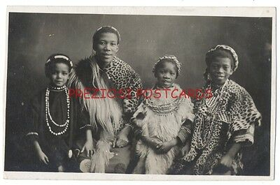 Beautiful RPPC - A Prosperous AFRICAN NATIVE FAMILY ca1910 Wears LEOPARD SKINS