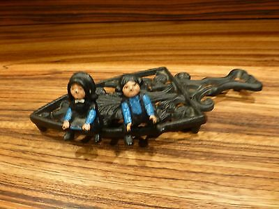 """Cast iron trivet along with pair cast iron sitting figurines 4"""" [Y6-W7-A8]"""