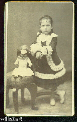 1880's original antique Cdv of a well dressed girl and her doll in a chair