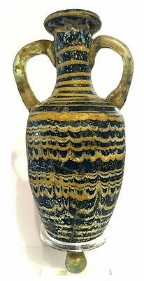 A Greek Core -Formed Glass Amphora .