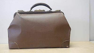 Antique leather covered doctor bag brass closures cloth interior metal handle