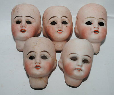 five painted bisque doll heads,Sonneberg
