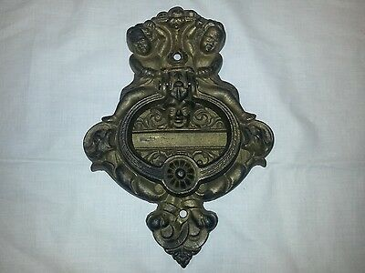 Antique Victorian  cast iron door knocker ornate with cherub putti